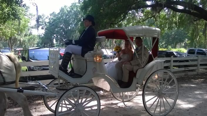 Carriage ride for the happy couple]